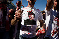 A celebrator wearing a shirt of Musa Al-Sadr, an Iranian who founded the Amal movement and who is said to have revived the Shi'a Islam in Lebanon. Al-Sadr disappeared mysteriously while on a trip abroad in the late 1970s.