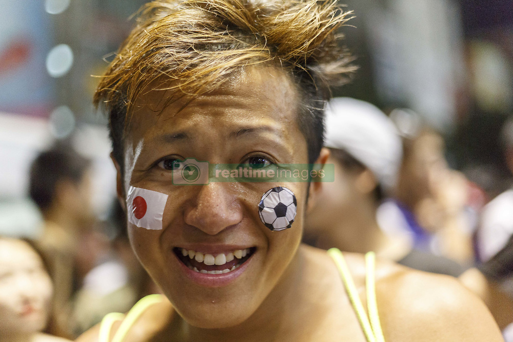 June 29, 2018 - Tokyo, Japan - A soccer fan celebrates in Shibuya after their team advanced to the second round of World Cup in Tokyo, Japan. Japan's Soccer National Team. Japan sealed their position to the second round of the FIFA World Cup despite losing to Poland 1-0 in Volgograd Arena in Volgograd, Russia. Soccer fans who watched the game in Tokyo gathered in Shibuya's famous scramble crossing to celebrate, the Tokyo Metropolitan Police were on hand to control access. (Credit Image: © Rodrigo Reyes Marin/via ZUMA Wire via ZUMA Wire)