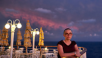Maria at dawn, only a few days since the hair was cut on board the MV World Odyssey. Day 65 of 103 of the Semester at Sea Spring 2016 Voyage at sea between Mauritius and South Africa. Image taken with a Fuji X-T1 camera and 23 mm f/1.4 lens (ISO 800, 23 mm, f/2, 1/60 sec)