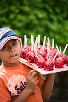 PENONOME, PANAMA - FEBRUARY 15: A kid brings a tray of candy apples to sell them at the carnival festivities in Penonome. February 15, 2010. Penonome, Panama. (Photo: Ruben Alfu / Istmophoto)