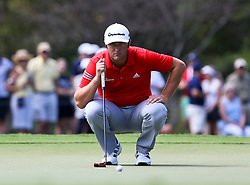 September 24, 2017 - Atlanta, Georgia, United States - Jon Rahm lines up a putt on the first green during the final round of the TOUR Championship at the East Lake Club. (Credit Image: © Debby Wong via ZUMA Wire)