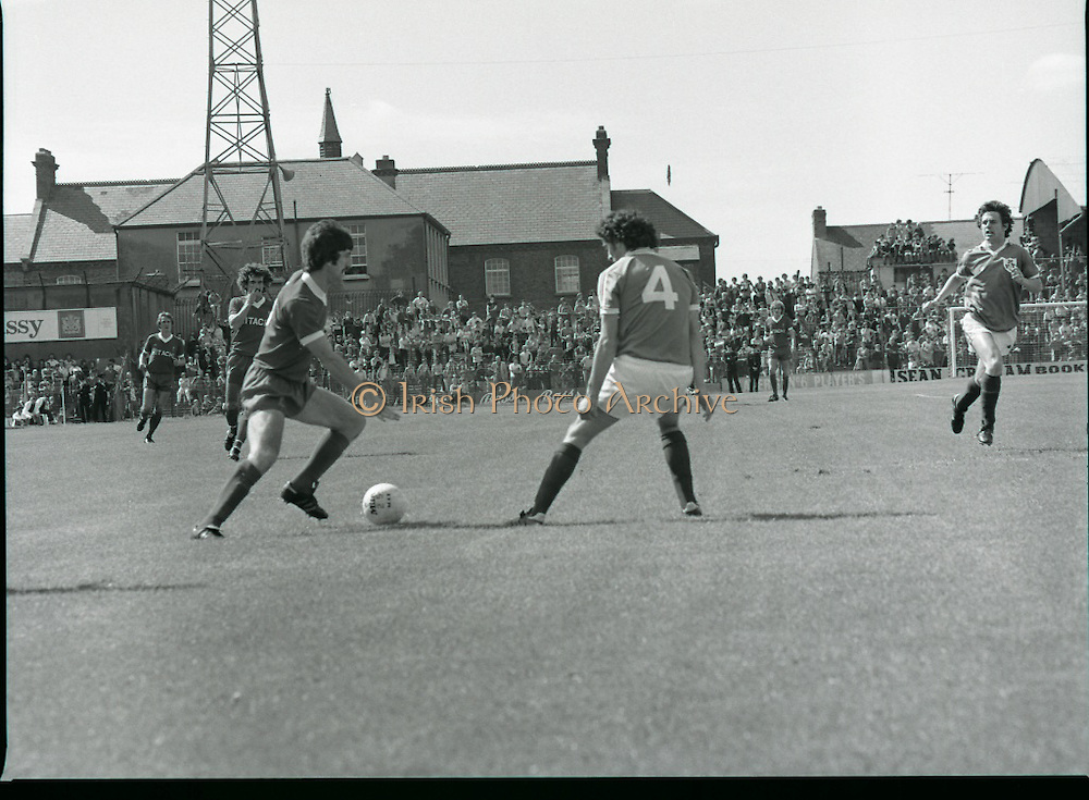 League of Ireland vs Liverpool FC.    (M87)..1979..18.08.1979..08.18.1979..18th August !979..In a pre season friendly the League of Ireland took on Liverpool FC at Dalymount Park Phibsborough,Dublin. The league team was made up of a selection of players from several League of Ireland clubs and was captained by the legendary John Giles. Liverpool won the game by 2 goals to nil..The scorers were Hansen and McDermott...Image shows David Johnson attempting to round defender John McCormack during this attack.