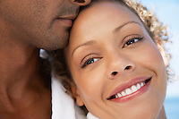Man and woman embracing close up of woman's face