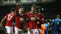 Matty Cash (R) and Tyler Walker (L) congratulate penalty goalscorer Kieron Dowell (C)  during The Emirates FA Cup Third Round match between Nottingham Forest and Arsenal at City Ground on January 7, 2018 in Nottingham, England.