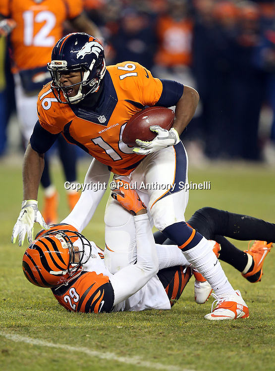 Denver Broncos wide receiver Bennie Fowler (16) tries to elude a tackle attempt by Cincinnati Bengals free safety Reggie Nelson (20) as he catches a first down pass inside field goal range with less than one minute left in the fourth quarter during the 2015 NFL week 16 regular season football game against the Cincinnati Bengals on Monday, Dec. 28, 2015 in Denver. The Broncos won the game in overtime 20-17. (©Paul Anthony Spinelli)