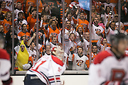 The Corner Crew chants after an RIT goal during a game against Brock University at the Gene Polisseni Center on Saturday, October 4, 2014.
