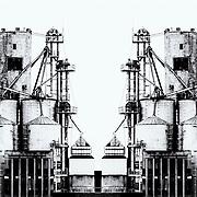 Mirrored black and white image of a grain silo