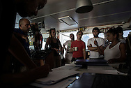 Italy: MSF Dignity1: After receiving a call for a rescue the Dignity1 crew has a meeting to decide how to act in case of emergency on August 23, 2015. Alessio Romenzi