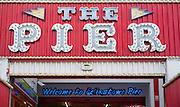 Neon signs at the amusement arcade on Felixstowe Pier, Suffolk, England