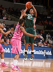 Miami (FL) forward Shenise Johnson (42) shoots a jump shot over Virginia forward Monica Wright (22).  The #21 ranked Virginia Cavaliers defeated the Miami Hurricanes 85-74 in overtime at the John Paul Jones Arena in Charlottesville, VA on February 19, 2009.