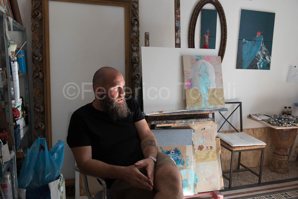 The artist Igor Scalisi Palminteri in his home studio