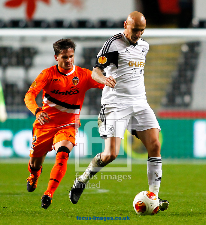 Picture by Mike  Griffiths/Focus Images Ltd +44 7766 223933<br /> 28/11/2013<br /> Jonjo Shelvey of Swansea City and Pablo Piatti of Valencia Club de F&uacute;tbol during the UEFA Europa League match at the Liberty Stadium, Swansea.