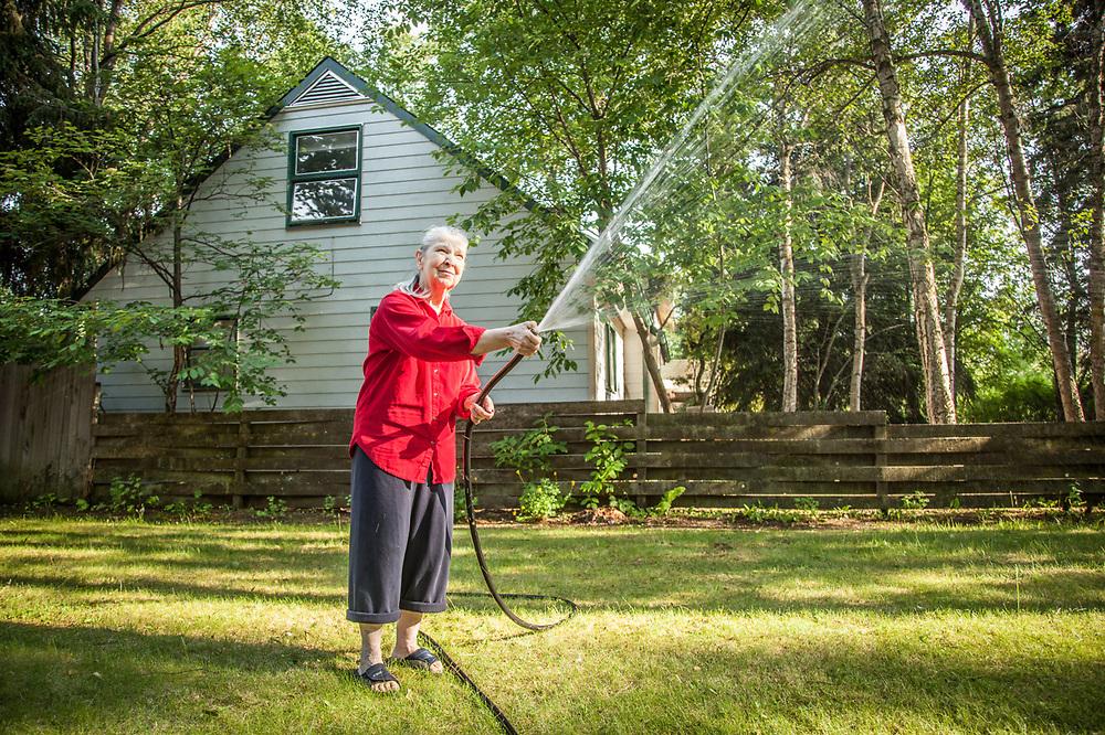 Retired high school teacher Marilyn Conaway in her front yard in the Roger's Park neighborhood of Anchorage.