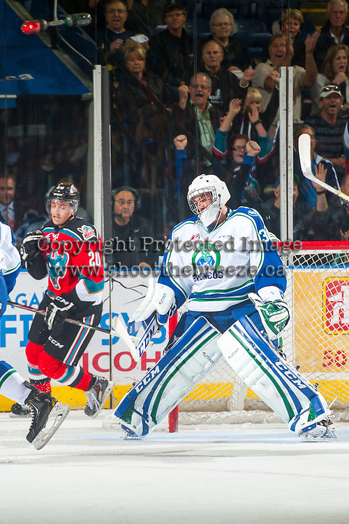 KELOWNA, CANADA - OCTOBER 7: Landon Bow #30 of Swift Current Broncos shows disappointment after Austin Glover #20 of Kelowna Rockets scores a goal on October 7, 2014 at Prospera Place in Kelowna, British Columbia, Canada.  (Photo by Marissa Baecker/Getty Images)  *** Local Caption *** Landon Bow; Austin Glover;