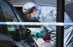 © Licensed to London News Pictures. 11/06/2018. London, UK. A police forensics officer looks for fingerprints on a car next to where a 17 year old was critically injured in a stabbing in Harrow last night. Another youth was stabbed in nearby Northolt.Photo credit: Peter Macdiarmid/LNP