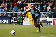 Wycombe defender Aaron Pierre gets to the ball ahead of Accrington defender Brad Halliday during the Sky Bet League 2 match between Wycombe Wanderers and Accrington Stanley at Adams Park, High Wycombe, England on 30 April 2016. Photo by David Charbit.
