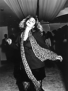 Woman Dancing in Club with Leopard Print Scarf, London, 1990s.