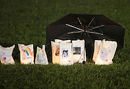 Pine Bush, New York - An umbrella protects candles from the rain during the Relay for Life on Saturday, June 12, 2010. Luminaries are purchased in memory of someone who lost their battle against cancer, or in honor of a survivor of the disease. The Relay for Life is a fundraiser for the American Cancer Society.