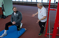 (L) Tomasz Majewski while his training session and his trainer coach (R) Henryk Olszewski at Sport's Academy (AWF) in Warsaw..Tomasz Majewski is a Polish shot putter and a double Olympic gold medalist..Poland, Warsaw, March 01, 2013..Picture also available in RAW (NEF) or TIFF format on special request...For editorial use only. Any commercial or promotional use requires permission...Photo by © Adam Nurkiewicz / Mediasport