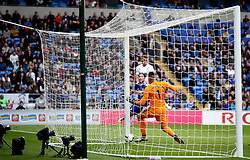 Cardiff City goalkeeper Neil Etheridge is unable to stop Burnley's Johann Gudmundsson (back) scoring his side's opening goal during the Premier League match at the Cardiff City Stadium.