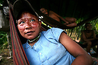 Nukak-Maku Indian woman lies in her hammock at their camp just outside of San Jose de Guaviare on November 20, 2006. The Indians at the camp are now part of Colombia?s displaced community. With limited exposure to the western world they have left behind their nomadic traditions in the Colombian jungle in a large part due to fear of the FARC, the leftist rebels who control much of the jungle that was traditionally inhabited by the Indians and that is now being used by the FARC to produce cocaine which finances their war. (Photo/Scott Dalton)
