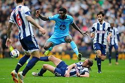 Emmanuel Adebayor (TOG) of Tottenham Hotspur is challenged by Jonas Olsson (SWE) of West Brom - Photo mandatory by-line: Rogan Thomson/JMP - 07966 386802 - 12/04/2014 - SPORT - FOOTBALL - The Hawthorns Stadium - West Bromwich Albion v Tottenham Hotspur - Barclays Premier League.