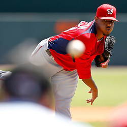 March 24, 2012; Sarasota, FL, USA; Washington Nationals pitcher Edwin Jackson throws during the bottom of the first inning of a spring training game against the Baltimore Orioles at Ed Smith Stadium.  Mandatory Credit: Derick E. Hingle-US PRESSWIRE