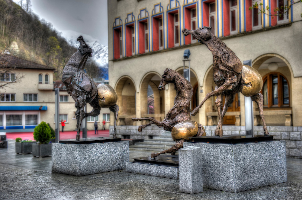 """Tre Cavalli"" (2002) statues of horses by Swiss artist Nag Arnoldi in front of the Vaduz Town Hall."