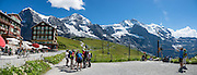"""Kleine Scheidegg pass. We walked downhill from Eigergletscher train station (of the Jungfraujoch """"Top of Europe"""" railway) under the north face of the Eiger (3970m / 13,020 ft elevation) to Alpiglen station in Grindelwald Valley, Canton of Bern, Switzerland, the Alps, Europe. The Eiger has the biggest north face in the Alps: 1800 vertical meters (or 5900 ft) of rock and ice. The Swiss Alps Jungfrau-Aletsch region is honored as a UNESCO World Heritage Site.The Swiss Alps Jungfrau-Aletsch region is honored as a UNESCO World Heritage Site. This image was stitched from multiple overlapping photos."""