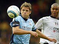 25/9/2004<br />FA Barclays Premiership - Fulham v Southampton - Craven Cottage<br />Southampton's James Beattie is tracked by Fulham's Zat Knight<br />Photo:Jed Leicester/BPI (back page images)