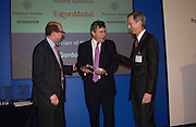 Nick Robinson, Gordon Brown  and Robert Olsen, Political Studies Association Awards 2004. Institute of Directors, Pall Mall. London SW1. 30 November 2004.  ONE TIME USE ONLY - DO NOT ARCHIVE  © Copyright Photograph by Dafydd Jones 66 Stockwell Park Rd. London SW9 0DA Tel 020 7733 0108 www.dafjones.com