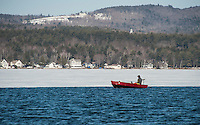 A lone angler navigates the limited open water at the mouth of the Winnipesaukee River on Lake Winnisquam Wednesday morning on opening day for landlocked fishing season.  (Karen Bobotas/for the Laconia Daily Sun)