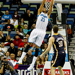 Dec 22, 2012; New Orleans, LA, USA; New Orleans Hornets power forward Anthony Davis (23) dunks over Indiana Pacers power forward Tyler Hansbrough (50) during the first quarter of a game at the New Orleans Arena. Mandatory Credit: Derick E. Hingle-USA TODAY Sports