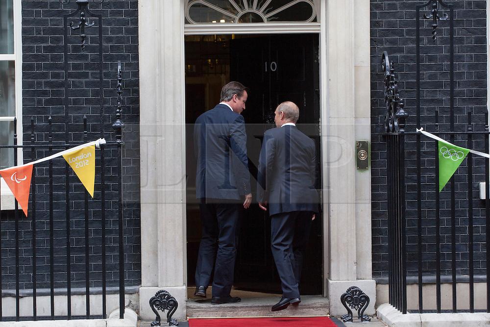 © licensed to London News Pictures. London, UK 02/08/2012. British Prime Minister David Cameron greeting President of Russia, Vladimir Vladimirovich Putin on Downing Street on 02/08/12. Photo credit: Tolga Akmen/LNP