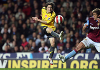 Photo: Rich Eaton.<br /> <br /> Aston Villa v Arsenal. The Barclays Premiership. 14/03/2007. Tomas Rosicky left of Arsenal tries a shot on goal as Stiliyan Petrov challenges