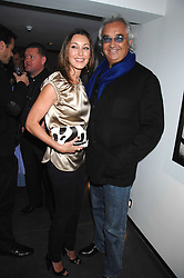 TAMARA MELLON and FLAVIO BRIATORE at a private view of Octagan a showcase of work of photographer Kevin Lynch featuring the stars of the Ultimate Fighter Championship held at Hamiltons gallery, Mayfair, London on 17th January 2008.<br />