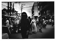 4..Bangsamoro woman wears a burkha.  Although Southeast Asia Islam is generally moderate, this woman covers her face, Quiapo District, Manila, Philippines.  It is an island of Islam in a sea of Catholicism.  When the Spanish arrived in Manila (Maynilad) 500 years ago, they found a Muslim settlement.  Ironically Manila's largest Catholic church, Quiapo Church, gives the district its name.
