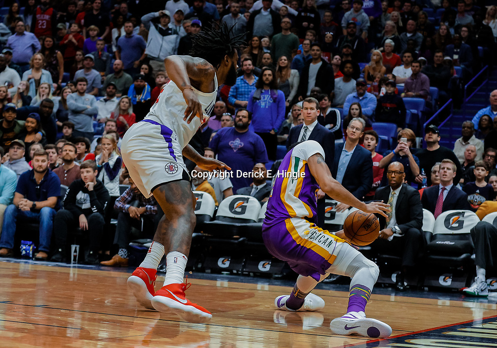 Jan 28, 2018; New Orleans, LA, USA; New Orleans Pelicans forward Anthony Davis (23) slips on the court turning the ball over as LA Clippers center DeAndre Jordan (6) defends late during the fourth quarter at the Smoothie King Center. The Clippers defeated the Pelicans 112-103. Mandatory Credit: Derick E. Hingle-USA TODAY Sports