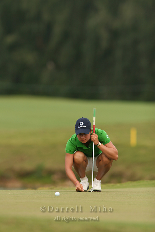 February 18, 2006; Kahuku, HI - Lorena Ochoa lines up her putt on the second playoff hole during the LPGA SBS Open at Turtle Bay Resort...Mandatory photo credit: Darrell Miho.© Darrell Miho
