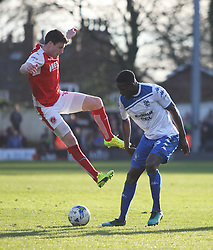 Bobby Grant of Fleetwood Town (L) and Leon Barnett of Bury in action - Mandatory by-line: Jack Phillips/JMP - 25/03/2017 - FOOTBALL - Gigg Lane - Bury, England - Bury v Fleetwood Town - Football League 1