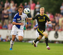 ZUG, SWITZERLAND - Wednesday, July 21, 2010: Liverpool's Lauri Dalla-Valle in action against Grasshopper Club Zurich's Guillermo Vallori during the Reds' first preseason match of the 2010/2011 season at the Herti Stadium. (Pic by David Rawcliffe/Propaganda)