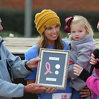 Tara Kilgore, center, recieved the first ever Breast Cancer Advocate award Saturday from Cancer Care