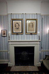 © Licensed to London News Pictures. 10/12/2012. London, UK. Lived . The portraits of Charles Dickens (L) and his wife Catherine, both painted by Samuel Laurence in 1837, are seen in the morning room of the Charles Dickens Museum, which re-opened its doors to the public in London today (10/12/12). The museum, spread over 4 floors, is housed in the building where Dickens lived with his wife from March 1837 to December 1839 and where he authored some of his famous titles including the Pickwick Papers, Nicholas Nickleby and Oliver Twist. Photo credit: Matt Cetti-Roberts/LNP