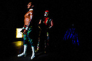 Lucha Libre AAA wrestlers Deccnis, left, and Abismo Negro, center, prepares backstage before a match in San Jose, CA March 29, 2009.