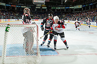 KELOWNA, CANADA - SEPTEMBER 28: Tanner Wishnowski #9 of Kelowna Rockets is checked by Shane Collins #19 in front of the net of Ty Edmonds #35 of Prince George Cougars on September 28, 2016 at Prospera Place in Kelowna, British Columbia, Canada.  (Photo by Marissa Baecker/Shoot the Breeze)  *** Local Caption *** Shane Collins; Ty Edmonds; Tanner Wishnowski;