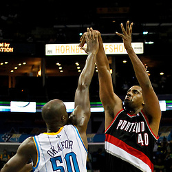January 16, 2012; New Orleans, LA, USA; Portland Trail Blazers center Kurt Thomas (40) shoots over New Orleans Hornets center Emeka Okafor (50)  during the third quarter of a game at the New Orleans Arena. The Trail Blazers defeated the Hornets 84-77.  Mandatory Credit: Derick E. Hingle-US PRESSWIRE