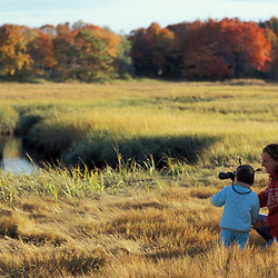 Biddeford, ME. A mother and daughter explore a salt marsh near Biddeford Pool.  TPL project - Anuszewski property.