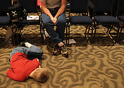 Matthew Huff sleeps on the floor of the Georgia State University ballroom during the 48th annual Georgia Spelling Bee. Huff's brother competed in the event.