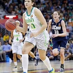 April 7, 2013; New Orleans, LA, USA; Notre Dame Fighting Irish forward Natalie Achonwa (11) dribbles against the Connecticut Huskies during the first half in the semifinals during the 2013 NCAA womens Final Four at the New Orleans Arena. Mandatory Credit: Derick E. Hingle-USA TODAY Sports