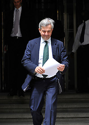 © licensed to London News Pictures. File picture dated 17/05/2011. London, UK.  Under fire Cabinet minister Chris Huhne was under fresh pressure today following the disclosure that he faces a complaint about his general election expenses. Pictured here leaving the cabinet office to go to the Office for Energy and Climate Change  (17/05/2011). Please see special instructions for usage rates. Photo credit should read Stephen Simpson/LNP